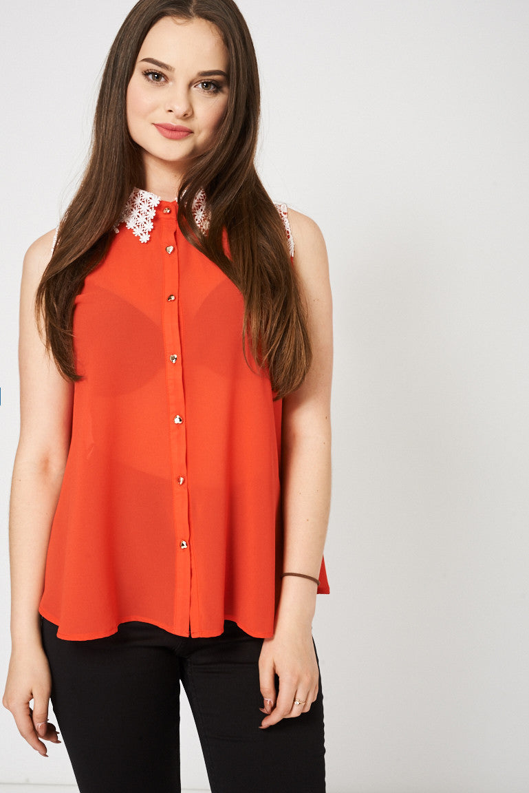 Ladies Orange Top With White Lace Detail