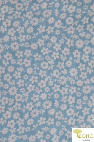 Little White Flowers on Light Blue. Poly Chiffon Woven Fabric. WV-142
