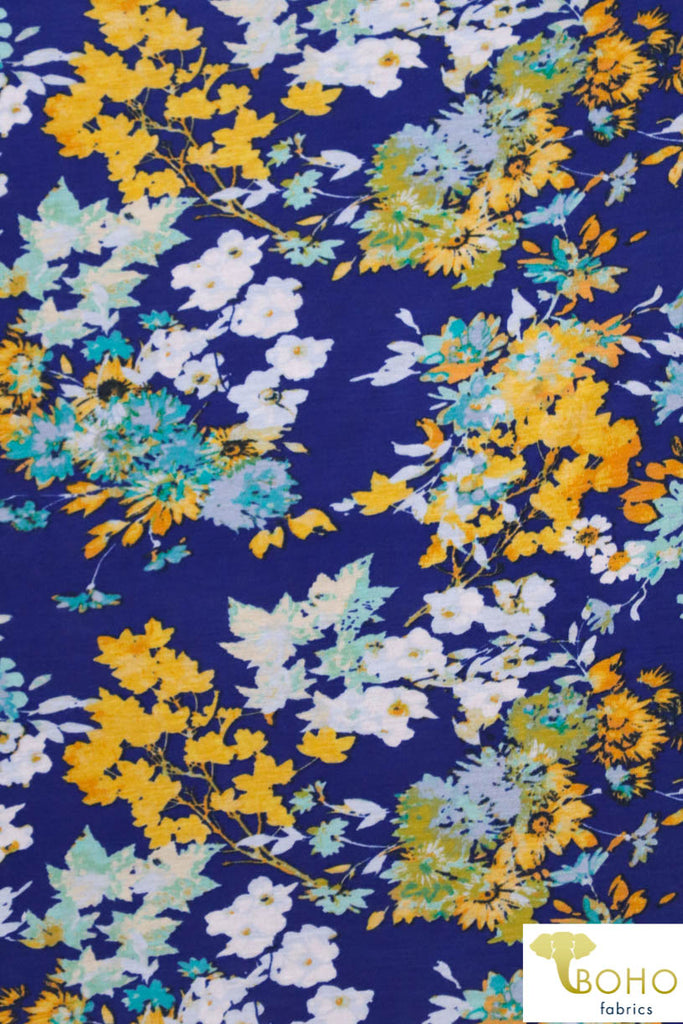 Sunshine Florals in Blues & Yellows on Royal Blue. Rayon Spandex Knit. R-133