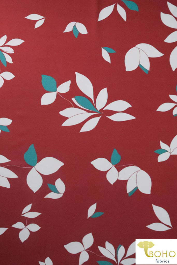 Falling Leaves in White & Teal on Brick Red.  Swim/Athletic Nylon Spandex Fabric