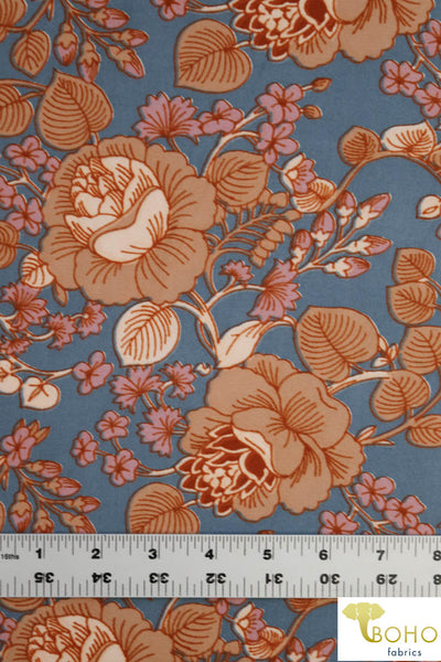 DBP: Lotus Vines in Nude and Mauve on Dusty Blue. Double Brushed Poly Knit Fabric. BP-112-BLU