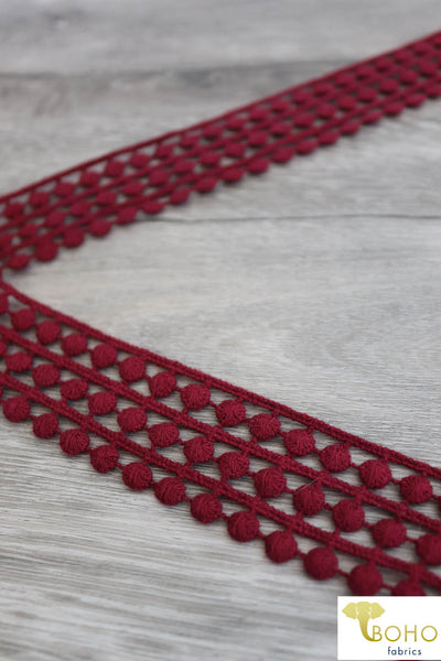 "Circular Road in Red Wine. 1.25"" Woven Trim."