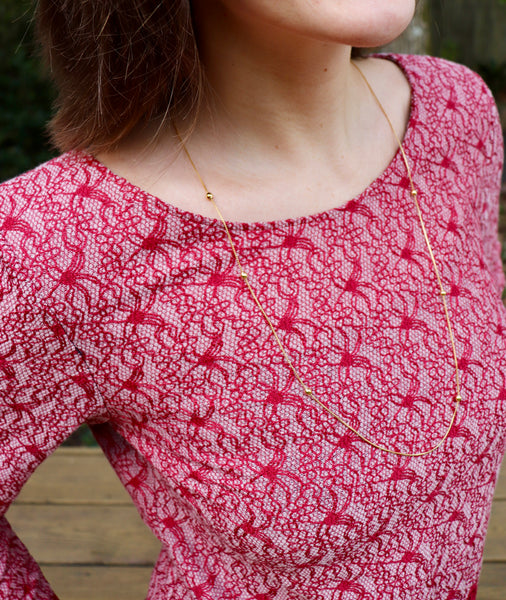 Classic Textured Lace In Red. Cotton Blend Woven Fabric. Designer End Bolt