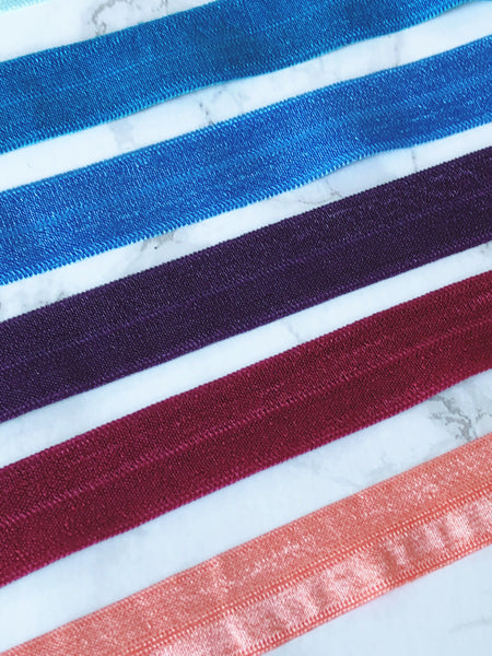 "Fold Over Elastic:  5/8"" Colors:  Black, Taupe, Steel Blue, Light Aqua, Caribbean Blue, Periwinkle, Plum, Burgundy and Peach"