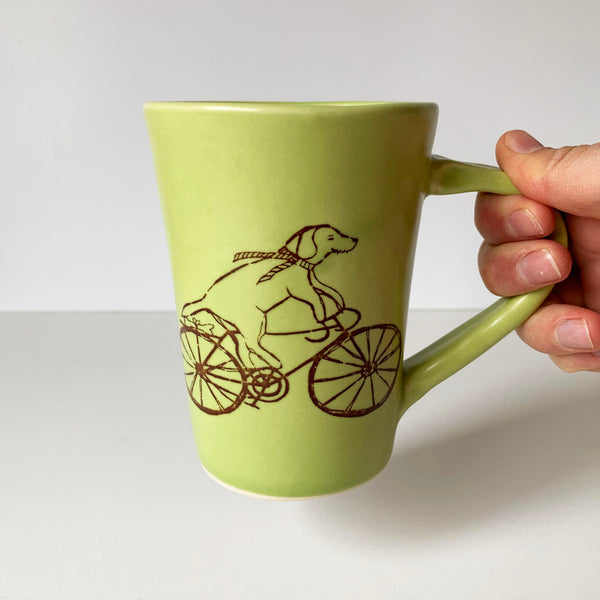 Coffee Mug - Illustrated Dog Riding a Bike Design