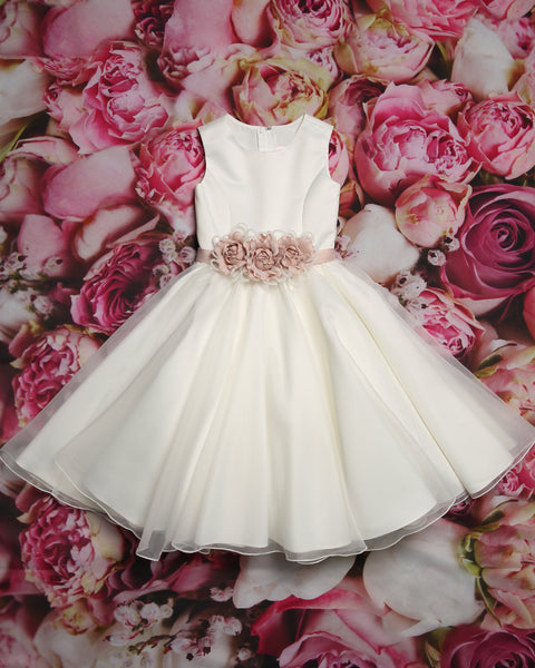 Pretty flower girl gown with a full floor-length gathered ball skirt from the Emma Bridals collection