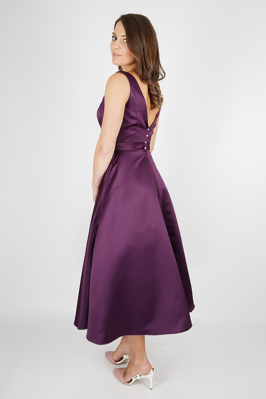 Tea length satin dress with flattering bateau neckline from the Emma Bridals collection