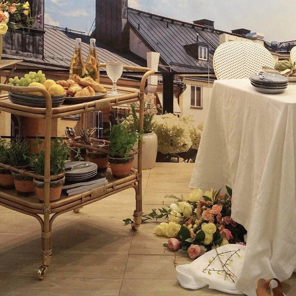 Capricho Carlo Trolley from Sika Design, styled with food in a romantic setting