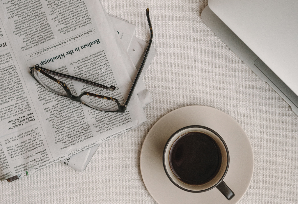 photo of newspaper and coffee