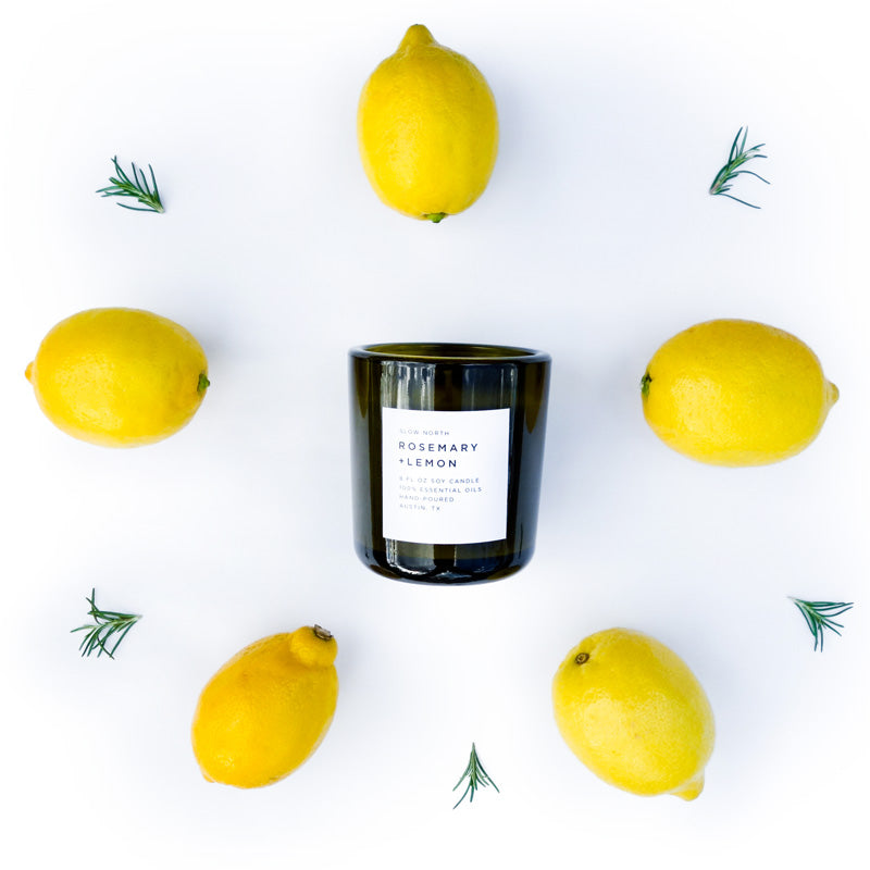 Rosemary Lemon vegan candle made with 100% essentail oils picture of 8oz tumber candle, lemons and sprigs of rosemary