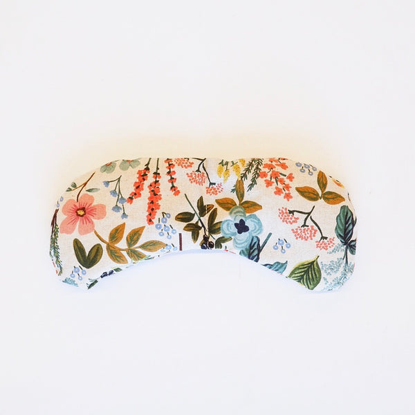 white eye mask with pink and blue flowers