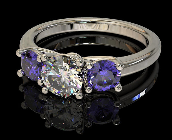 Ring with a trio of gemstones