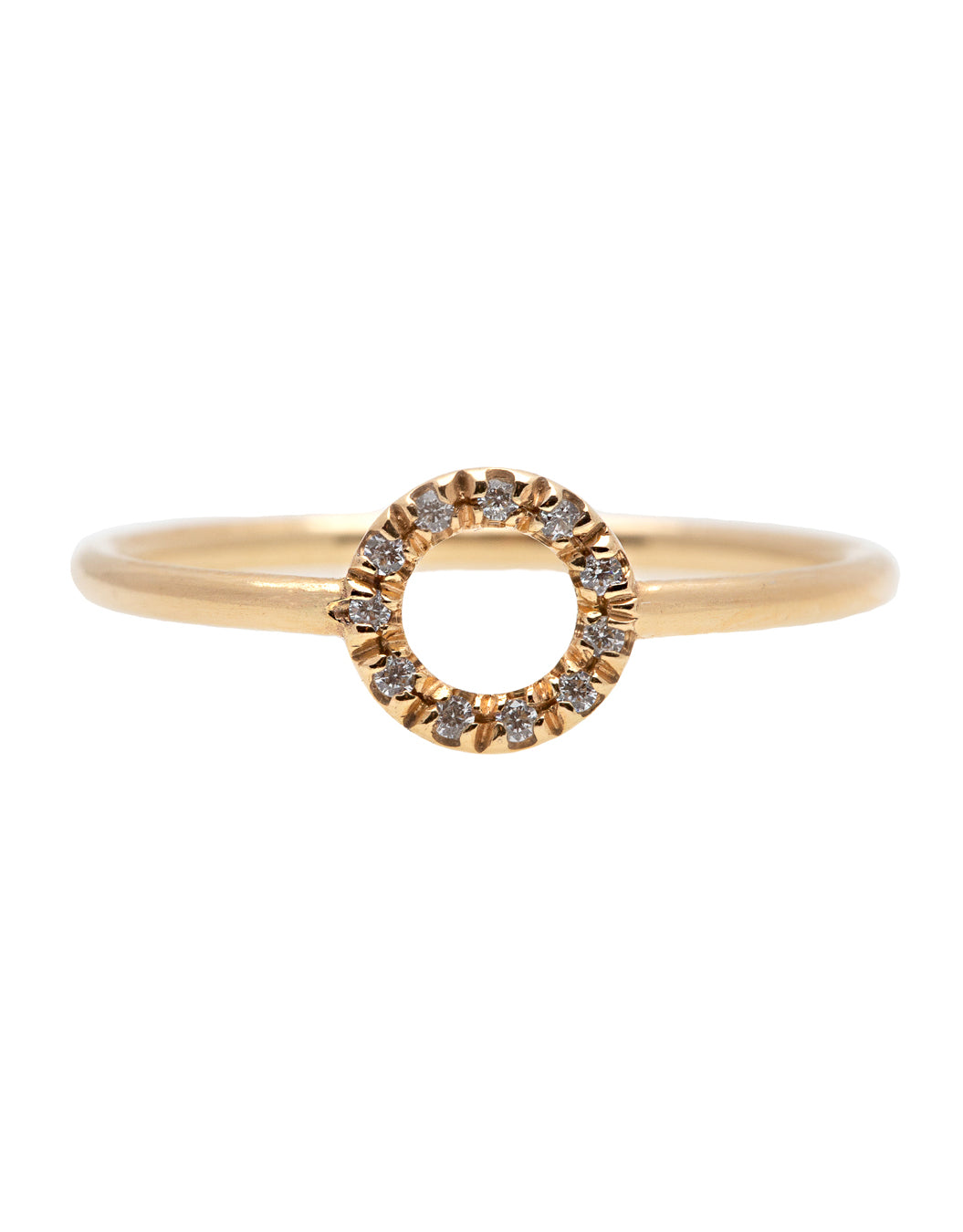 A dainty 14k yellow gold ring with a circle on top, set with brilliant cut white diamonds.