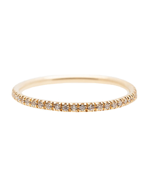 A dainty 14k yellow gold eternity ring, set with fifty 0.01 carat white diamonds all over.