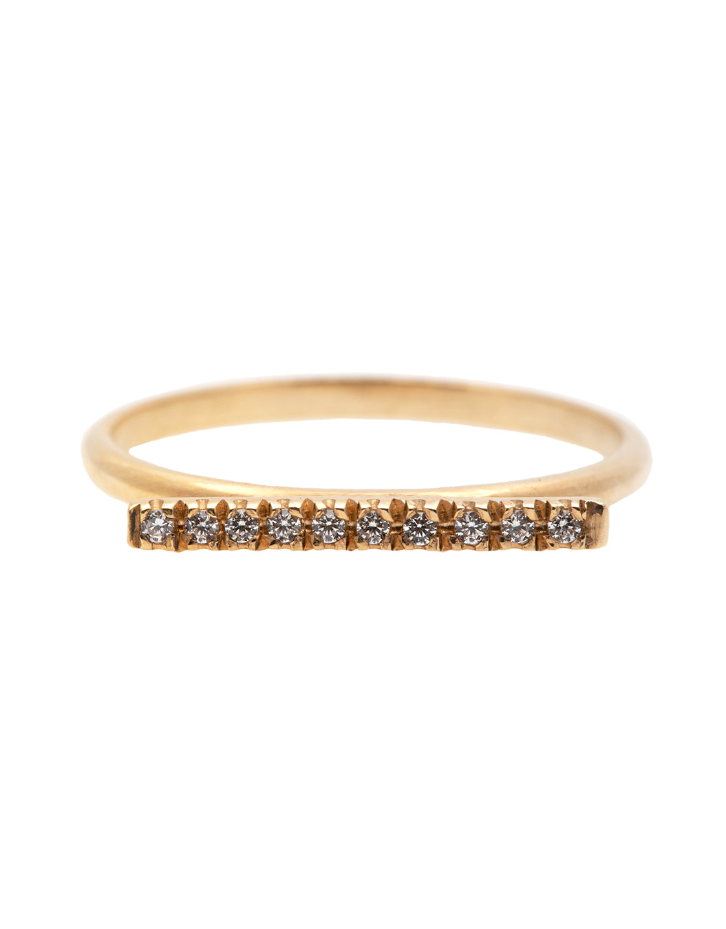 A dainty 14k yellow gold ring, with a horizontal bar on top, set with ten tiny white diamonds.