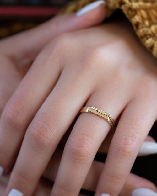 A dainty 14k yellow gold stackable ring.