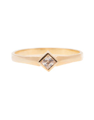 A delicate 14k yellow gold engagement ring set with a center 0.25 carat princess cut white diamond.