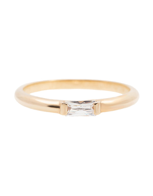 A 14k yellow gold engagement ring, set with a 0.25 baguette cut white diamond.