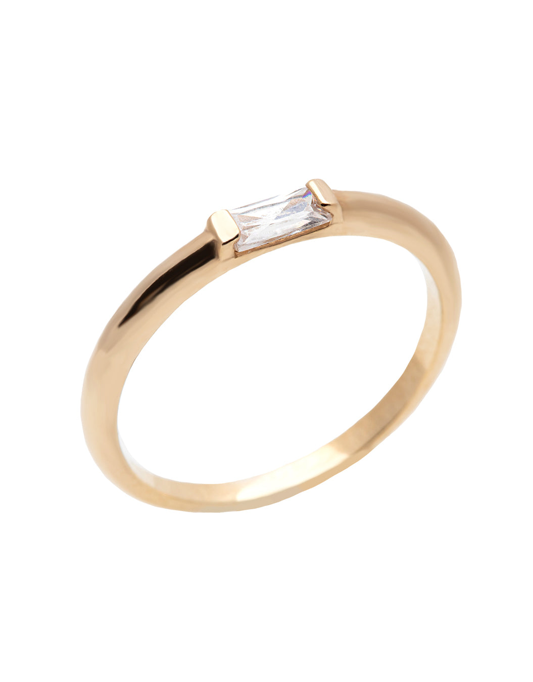 A  delicate 14k yellow gold engagement ring, set with a 0.25 baguette cut white diamond.