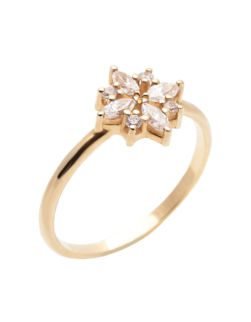 A delicate 14k yellow gold engagement ring set with four marquise cut white diamonds, and four brilliant cut white diamonds, in a shape of a snowflake.