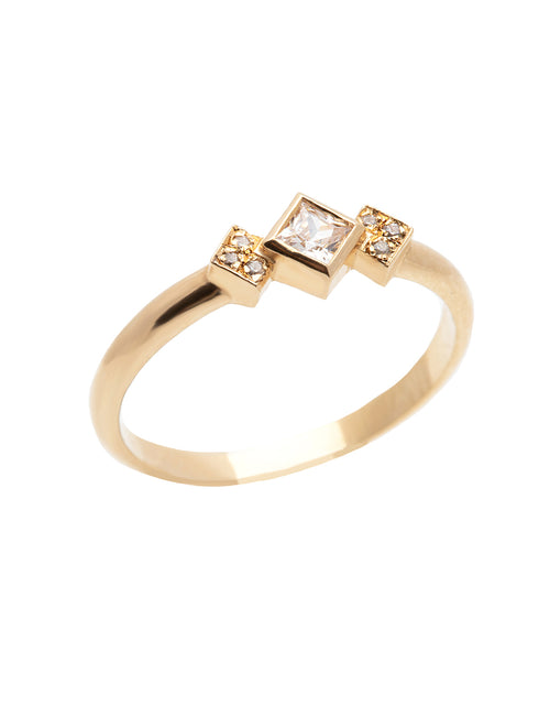 A delicate 14k yellow gold engagement ring, set with a center 0.25 carat princess cut white diamond, and three 0.01 carat brilliant cut white diamonds on each side.