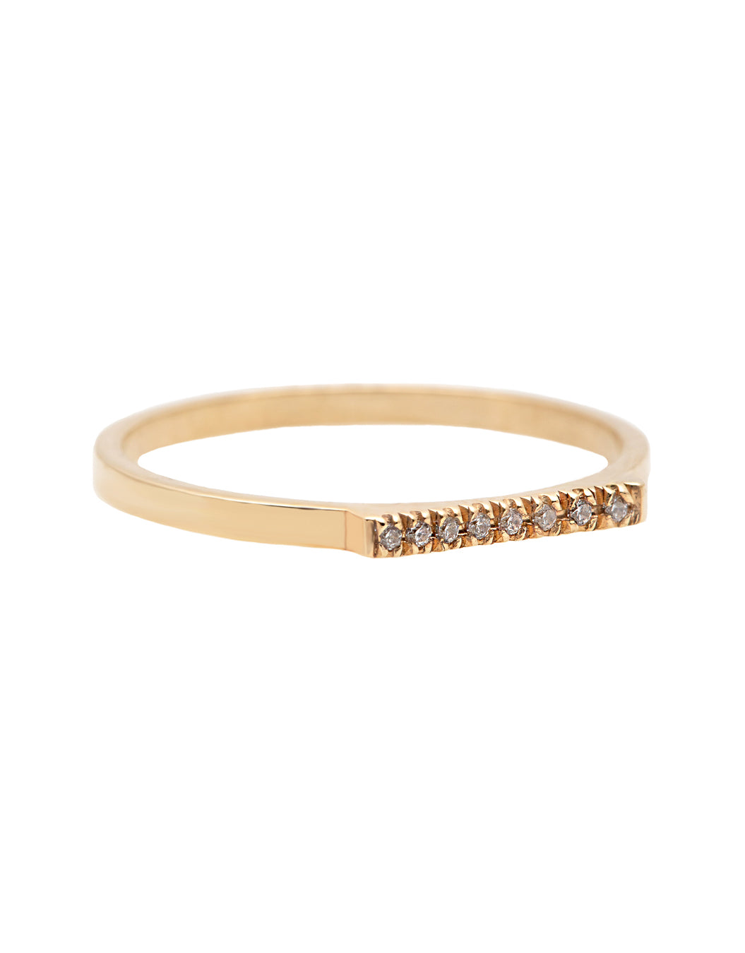 A delicate 14k yellow gold ring with a flat top set nine brilliant cut white diamonds, 0.01 carat each.