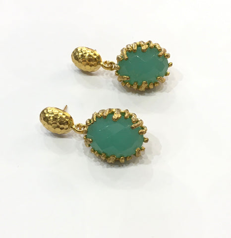 Gold earrings, green stone