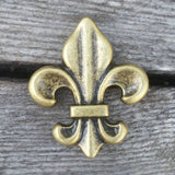 "2470WS-M12 1 1/2"" Antique Brass Fleur De Lis Decorative Wood Screw, Decorative Metal Pieces - Behind The Wire Shop"