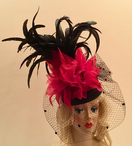 """JACKIE"" Black pillbox hat with large red flowers, black veil and black coque feathers"
