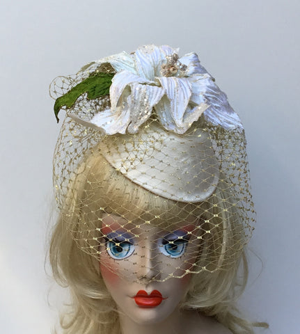 """Let it Snow"" cream silk hat with a cream poinsettia perfect for day or night."