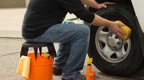 The Original Bucket Stool™ being used for car detailing. Click to see car detailing solutions page.