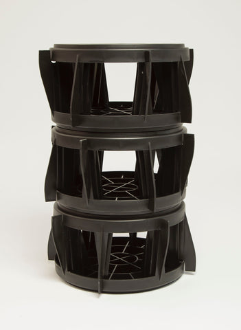 The Original Bucket Stool™ was designed to nest for compact storage. Six Bucket Stools™ pictured together.