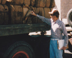 Mel Myland inspecting a load of burlap