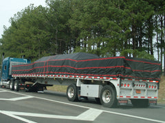 flat bed truck with lumber tarps