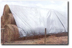 hay stack covered with Hay Tarp