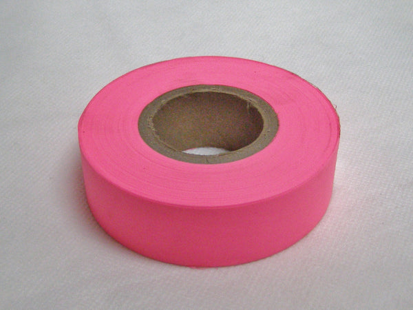 Fluorescent pink surveyors tape