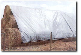 hay stack covered with a hay tarp