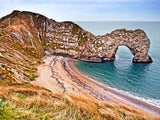 arch by the sea with sandy beach