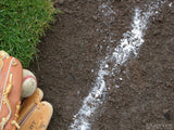 baseball in glove on chalk line