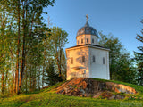 chapel on a hill at sunset