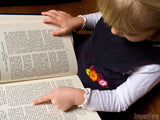 young child reading the bible