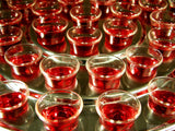 closeup of communion cups in tray