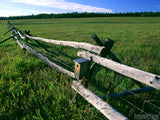 old wood and wire fence dividing pastures