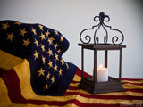 flag draped background and freedom light candle