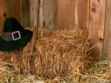 hay bale in barn with Amish hat