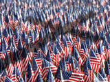 sea of us flags cross shadow he is with us