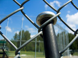 baseball bat hung on chain link fence
