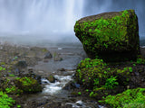 misty background from water fall and mossy rocks