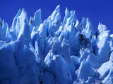 peaks of snow and ice in blue sky