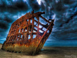 dark stormy skies over the Peter Iredale shipwreck